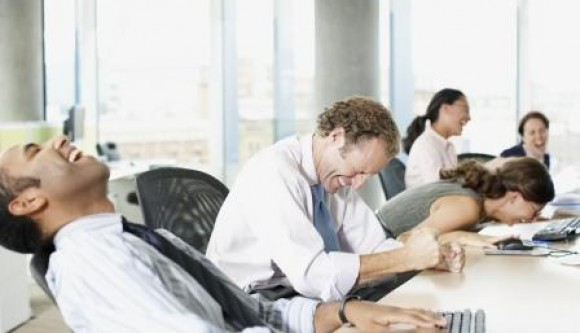 rex-business-people-laughing-in-office-580x333